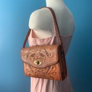 Vintage hand tooled leather purse with brass clasp